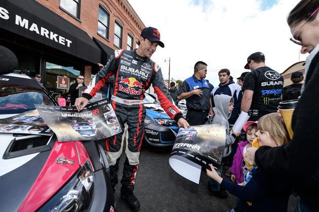 Travis Pastrana signs autographs for fans at the Oregon Trail Rally in Hood River, Oregon in May 2014.