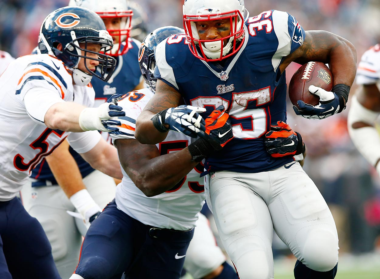 Jonas Gray fights his way through the Chicago Bears on Sunday.