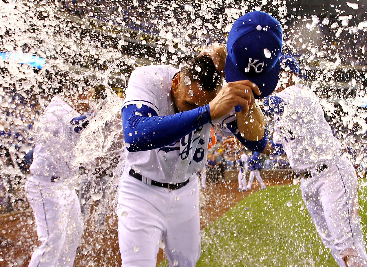 Paulo Orlando of the Kansas City Royals is doused with water by teammates Salvador Perez and Christian Colon after the Royals defeated the Oakland Athletics 6-4.