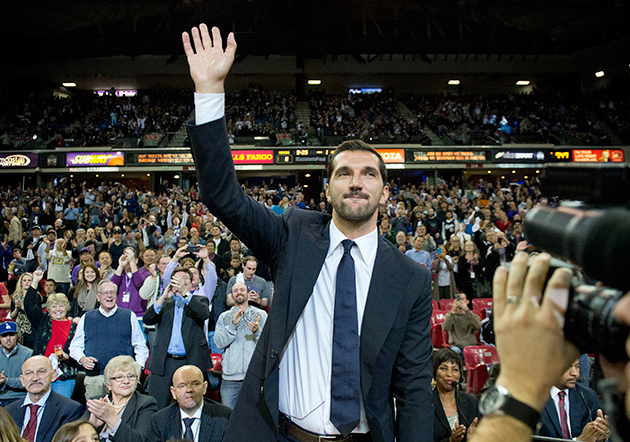 Peja Stojakovic, a central figure of the great Kings teams of the late-90s and early-2000s, waves to fans as his number is retired.