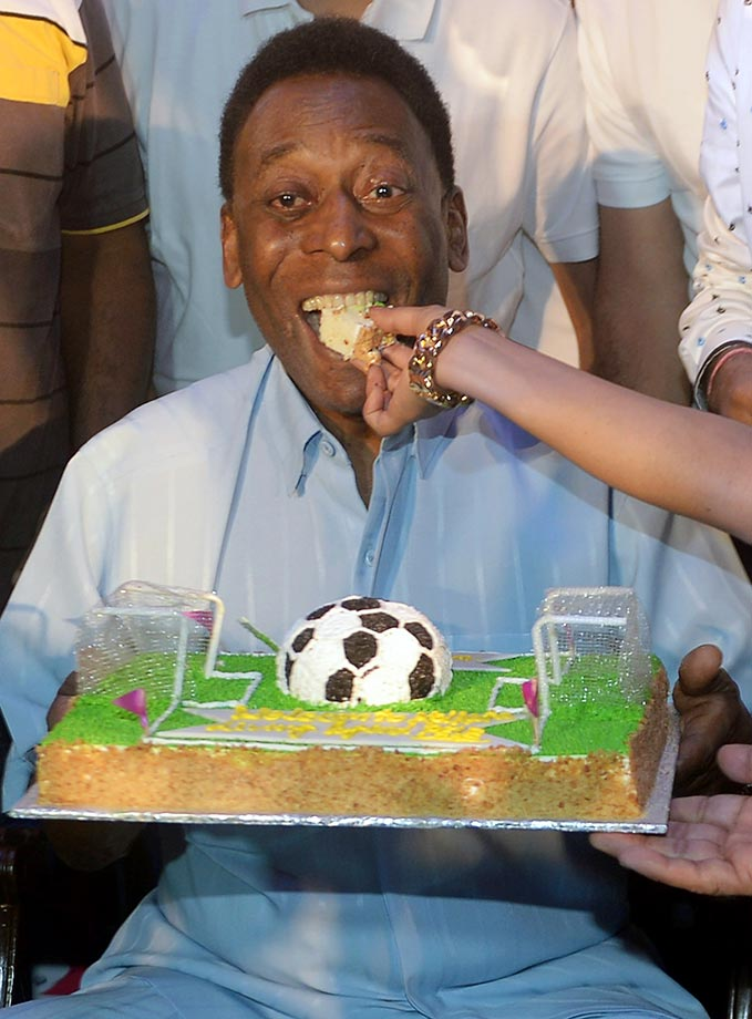 Pele eats a piece of cake made for his upcoming 75th birthday (on Oct. 23).