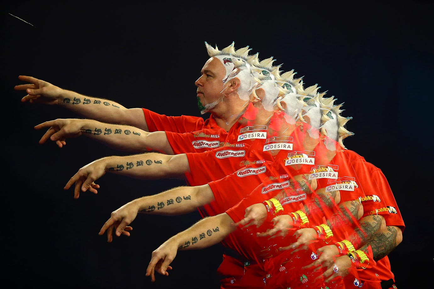 Multiple exposure picture of Peter Wright throwing during the 2016 William Hill PDC World Darts Championships in London.