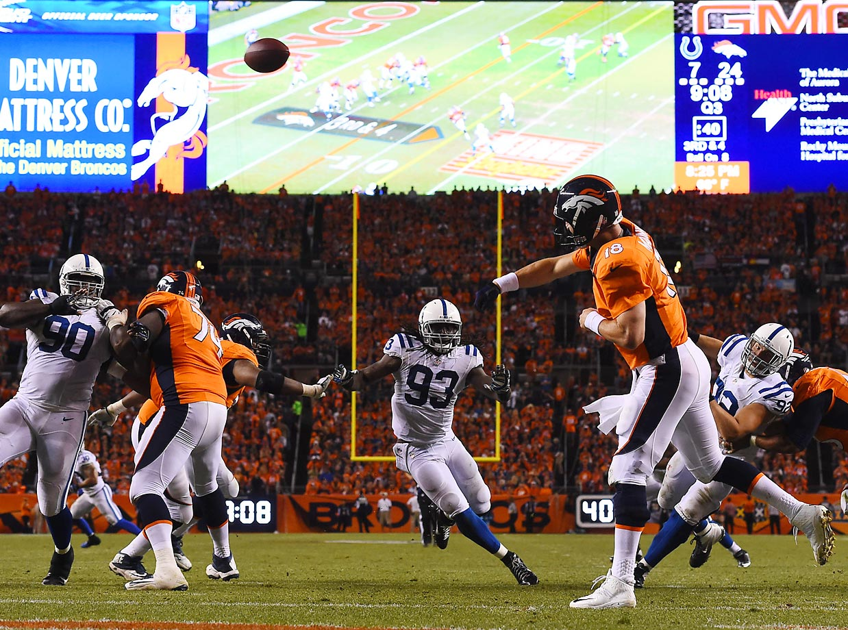 Peyton Manning throws in the second half of a 31-24 win over the Colts.