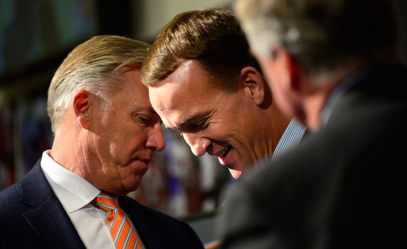 Manning with Elway, the man who brought him to Denver.