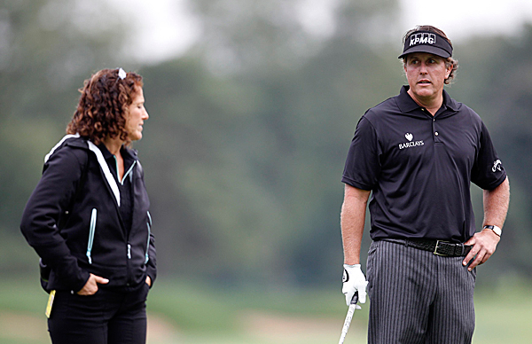 Phil Mickelson talks with sports psychologist Julie Elion before his tee shot at the PGA Tour's FedExCup BMW Championship in 2011.