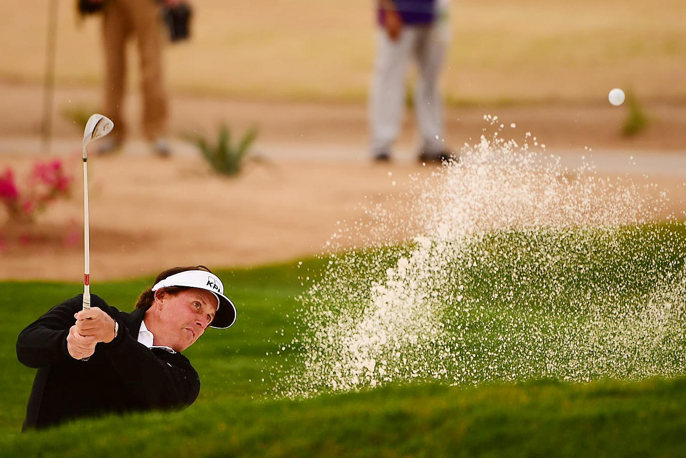Phil Mickelson hits his third shot on 13 out of the green side bunker during Round 1 of the 2015 Waste Management Phoenix Open.