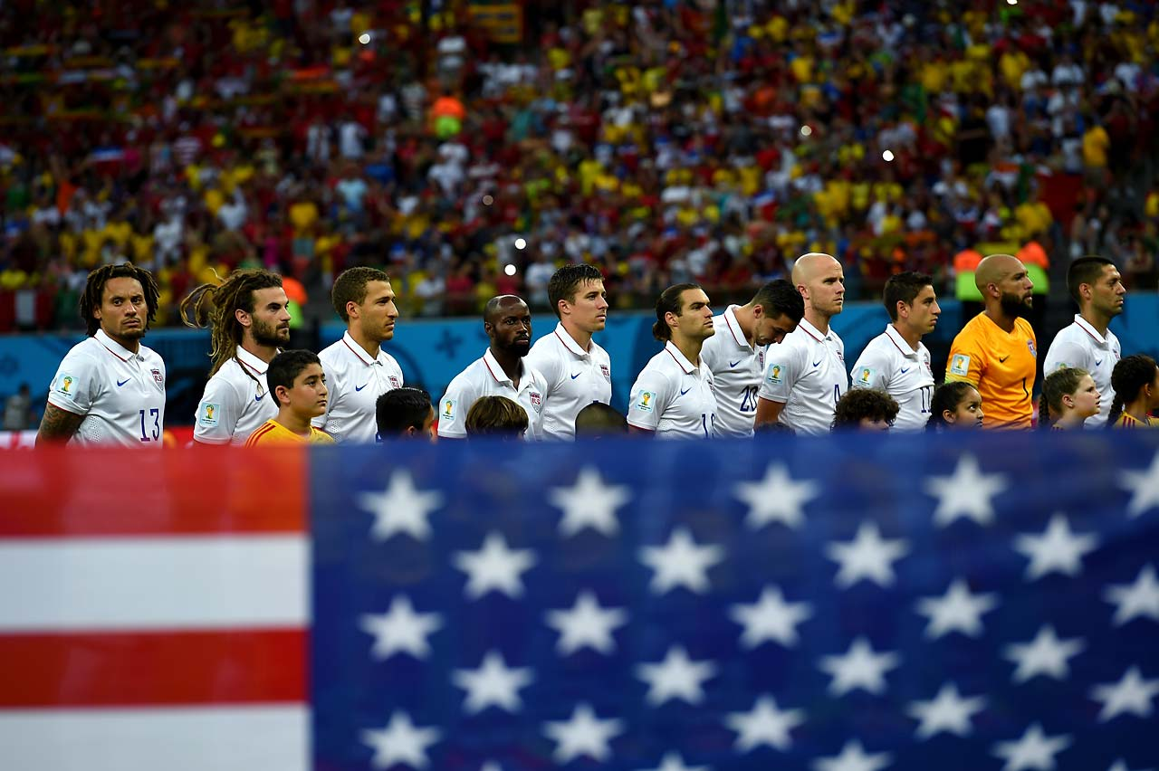 The United States players line up for the national anthem prior to the match.