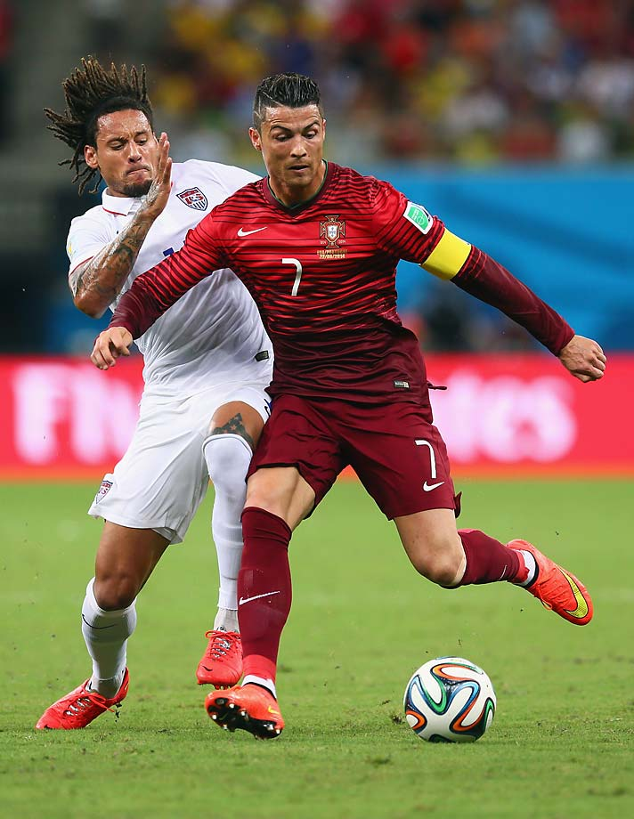 Jermaine Jones of the United States challenges Cristiano Ronaldo.