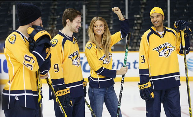 Kate Bock hits the ice with Roman Josi, Filip Forsberg and Seth Jones of the Nashville Predators