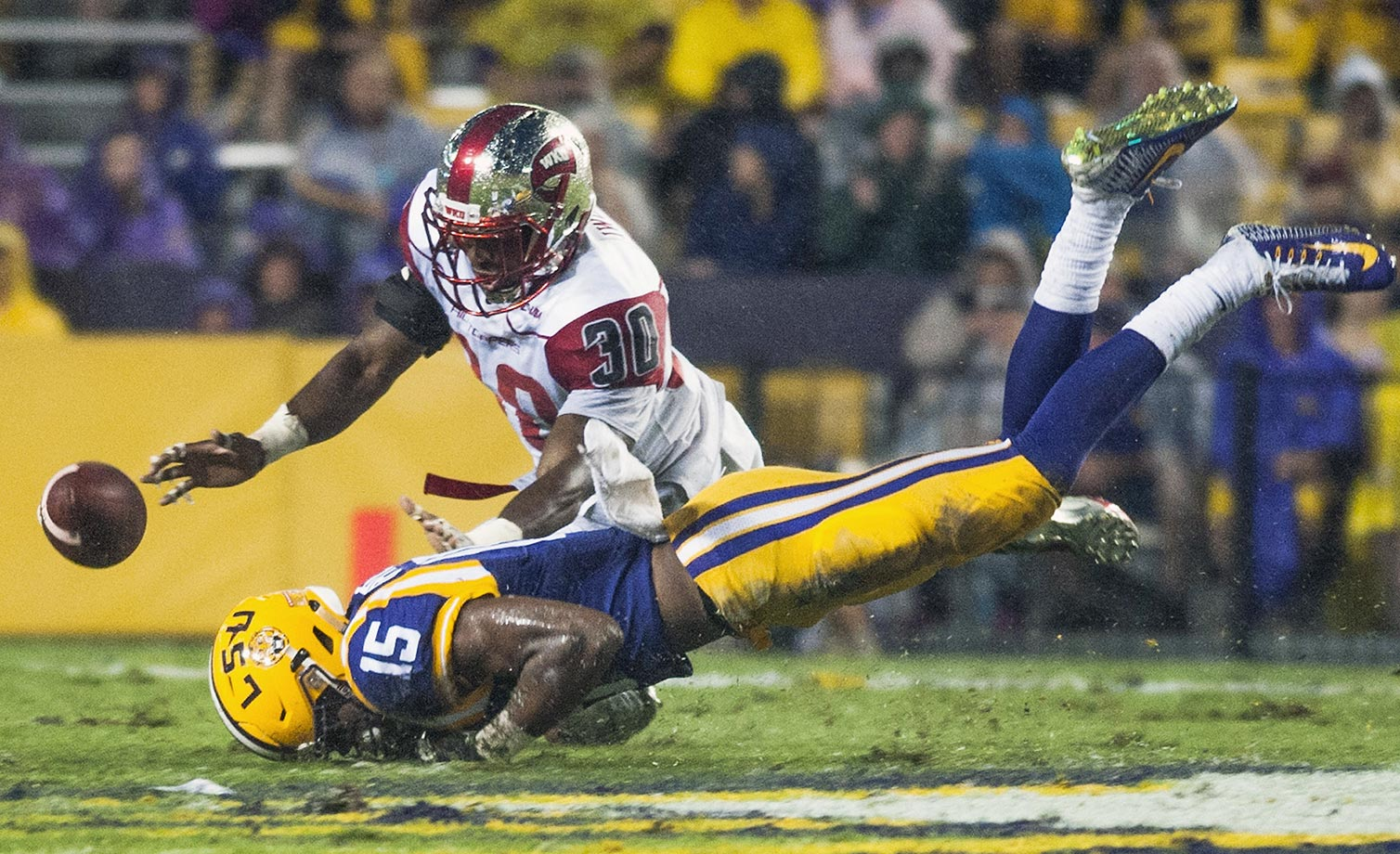 Prince Charles Iworah of Western Kentucky dives for a ball with Malachi Dupre of LSU.  The pass fell incomplete.