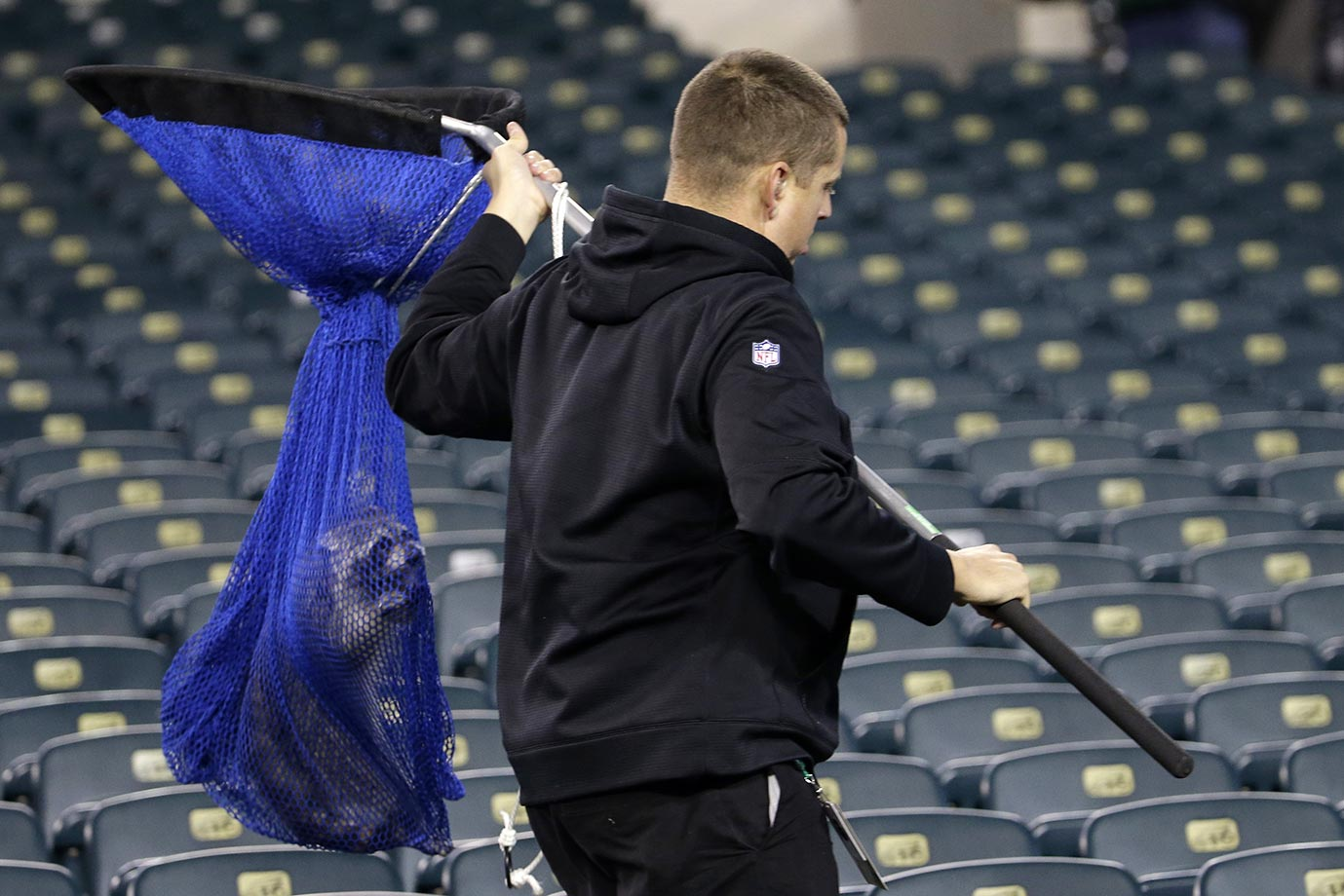 A raccoon is carried out of Lincoln Financial Field before the start of a Giants game.