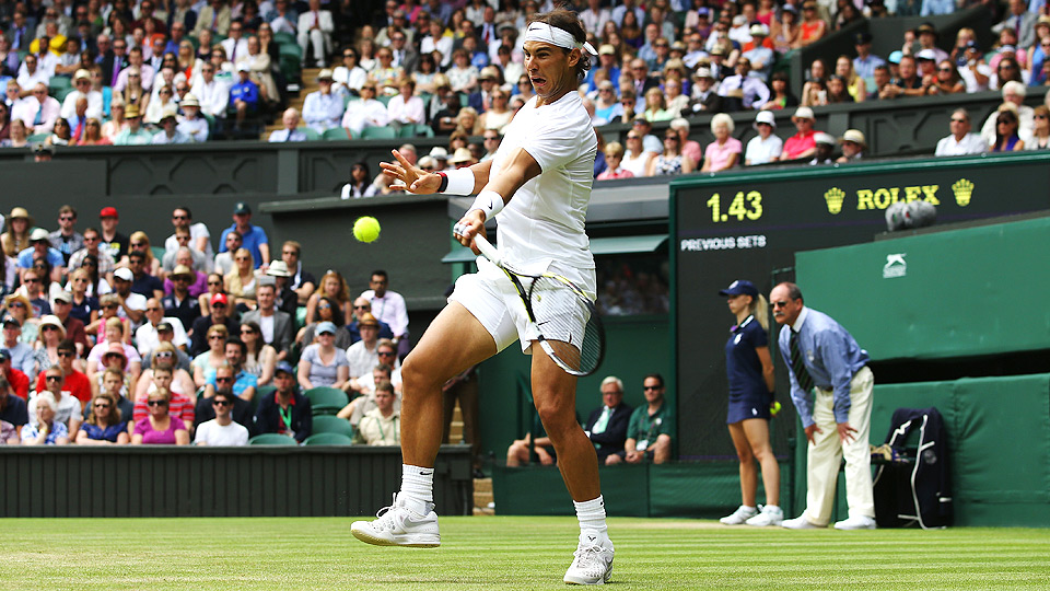 Rafael Nadal fended off Lukas Rosol, who beat him in the second round of Wimbledon two years ago.