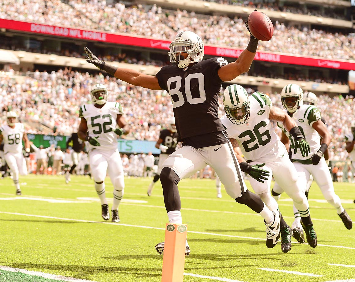 Oakland Raiders receiver Rod Streater celebrates scoring on a 12-yard reception in the first quarter against the New York Jets.