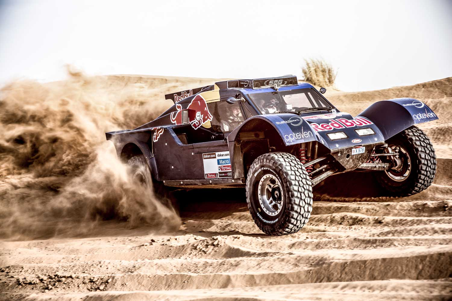 A rally car driver grinds through the desert terrain in a Subaru-powered Zero One racing buggy.