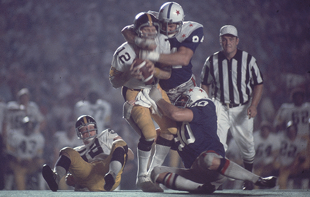 Randy White sacks Steelers QB Terry Bradshaw in the 1975 College All-Star game.