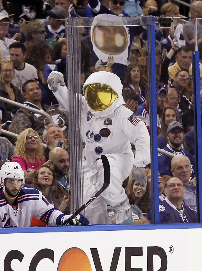 A Tampa Bay Lightning fan dressed as an astronaut dances during Game 4 of the Stanley Cup Playoff Eastern Conference finals.
