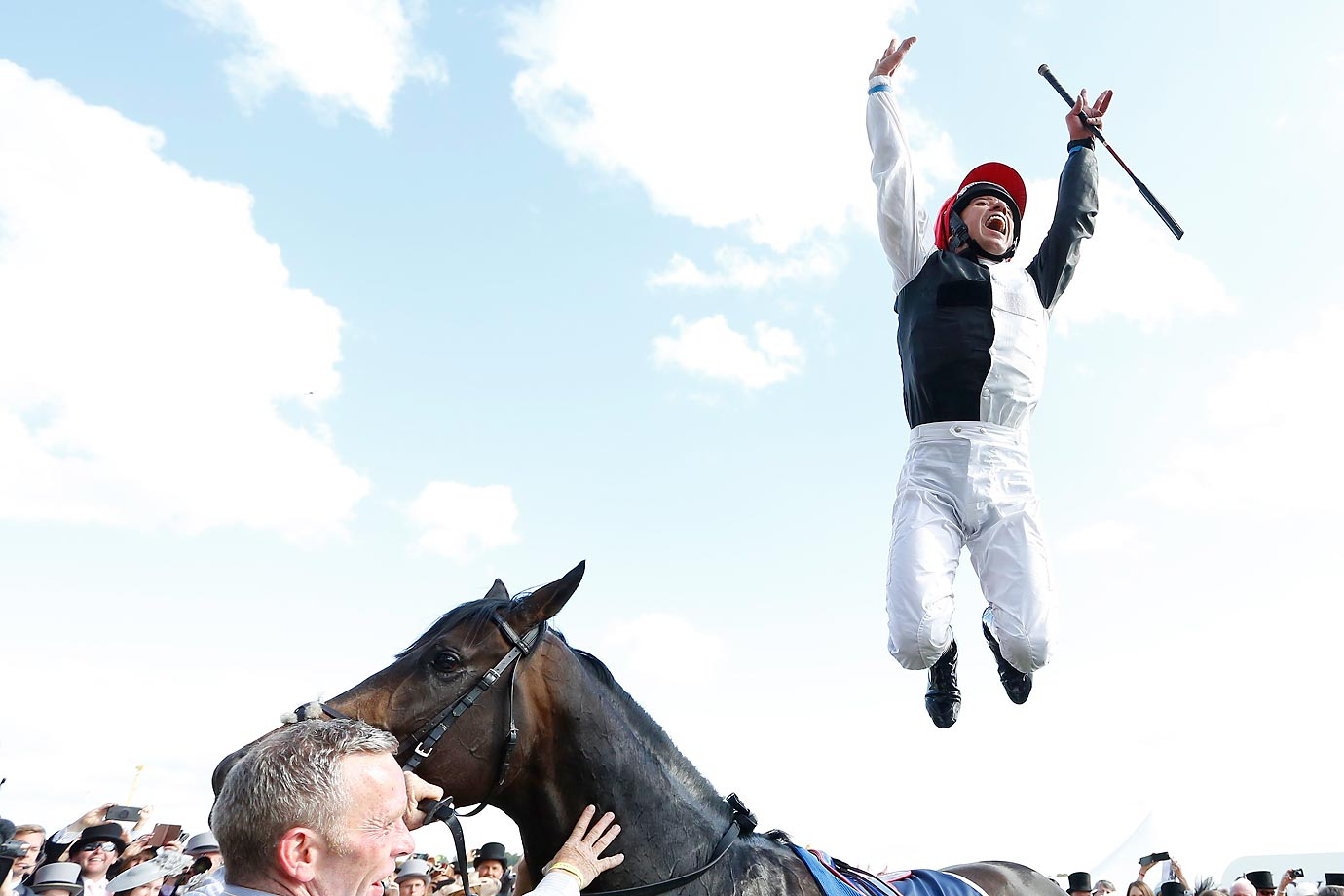Jockey Frankie Dettori jumps for joy from Golden Horn after his victory at The Investec Derby in Epsom, England on June 6.