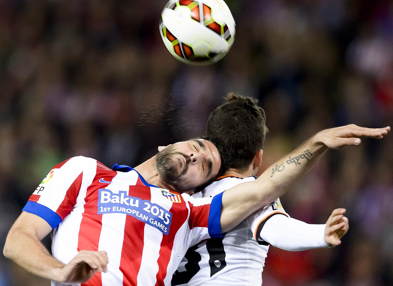 Atletico Madrid's midfielder Raul Garcia (left) vies with Valencia's Jose Gaya during the Spanish league football match Atletico Madrid vs Valencia CF.