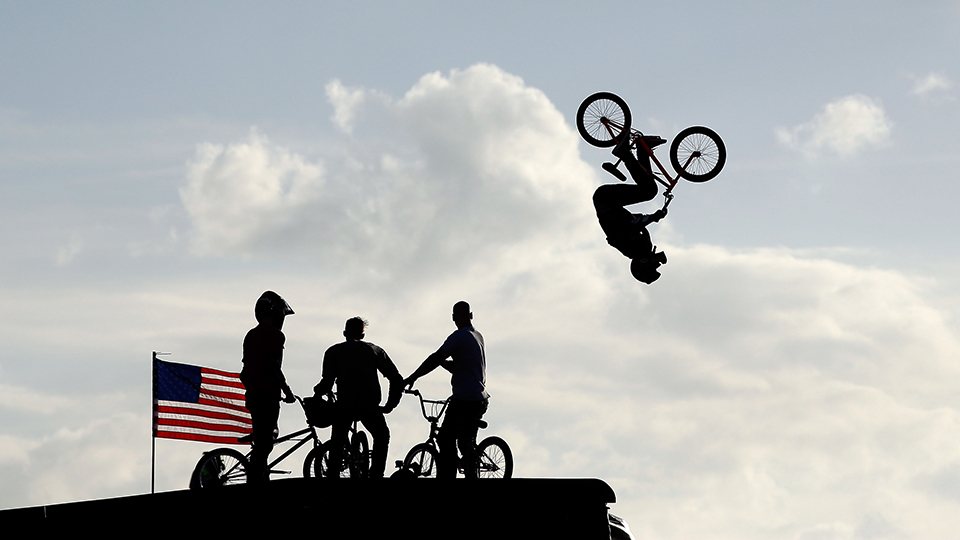 Riders watch as Steve McCann of Australia warms up for the BMX Big Air finals during X Games Austin at Circuit of The Americas.