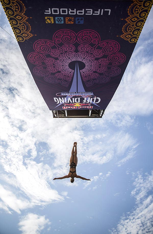 Lysanne Richard dives from the 22 metre platform during the first training session of the seventh stop of the Red Bull Cliff Diving World Series in  Italy.