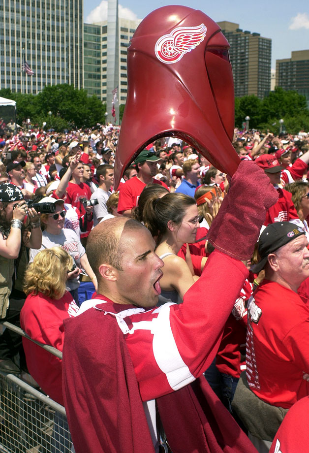 A Detroit Red Wings fan dressed in an Imperial Guard outfit cheers during the team's Stanley Cup celebration rally on June 17, 2002 in Detroit.