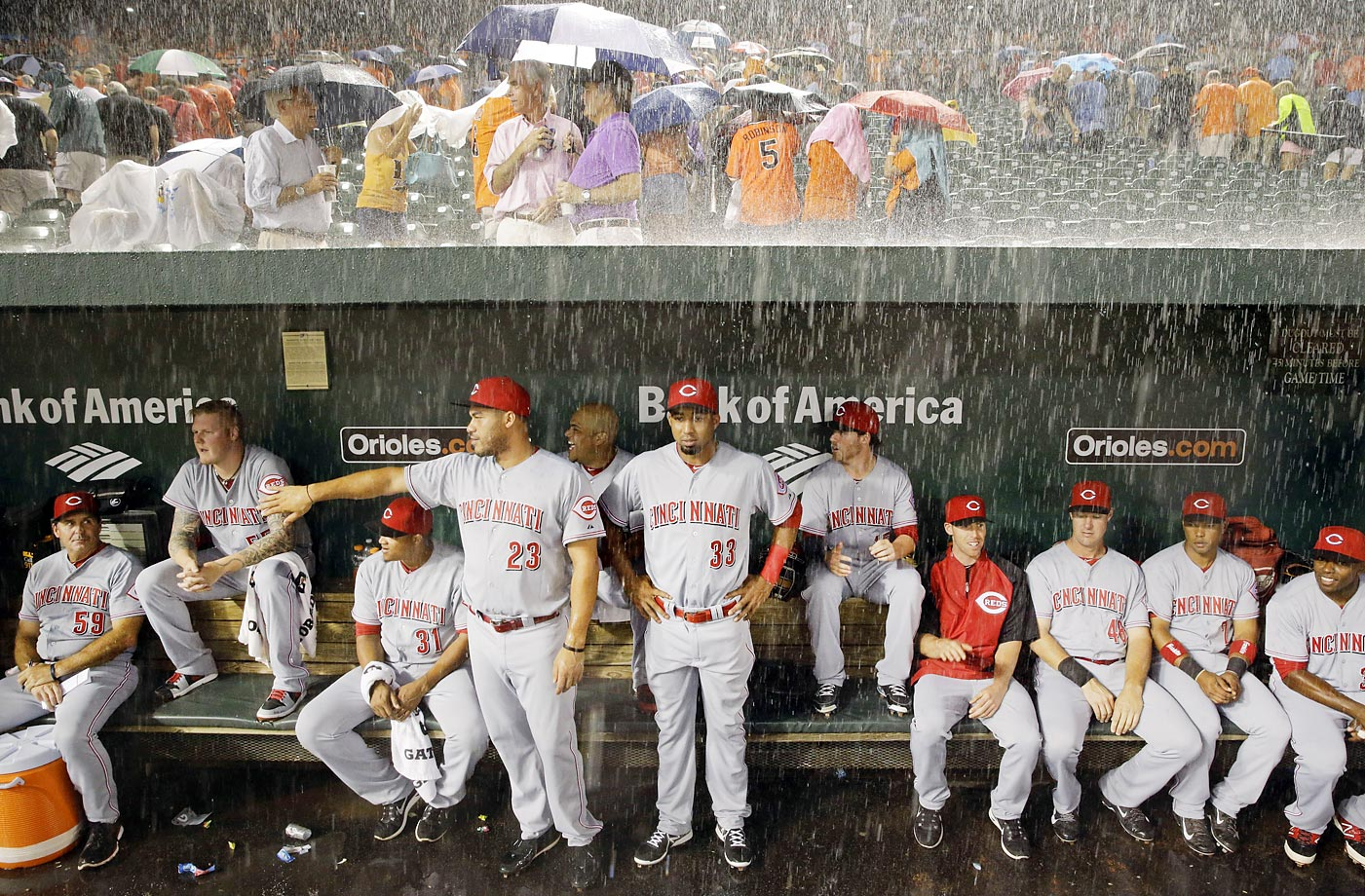 Heavy rain falls on the Cincinnati Reds during a Sept. 2 game against the Baltimore Orioles.