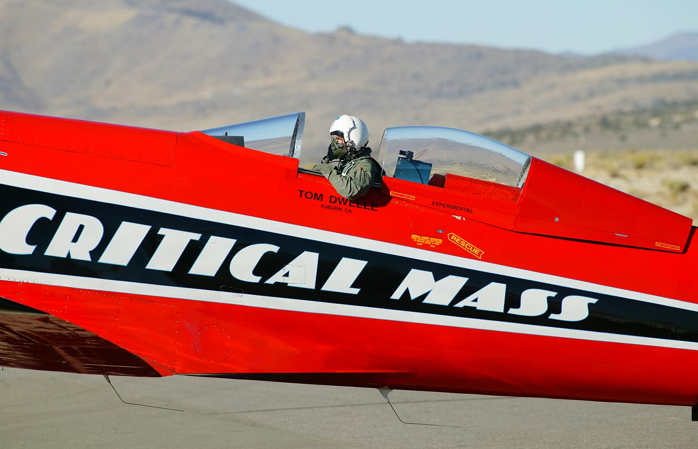 Pilot Tom Dwelle sitting in his airplane, Critical Mass, at the 2003 Reno Air Races.