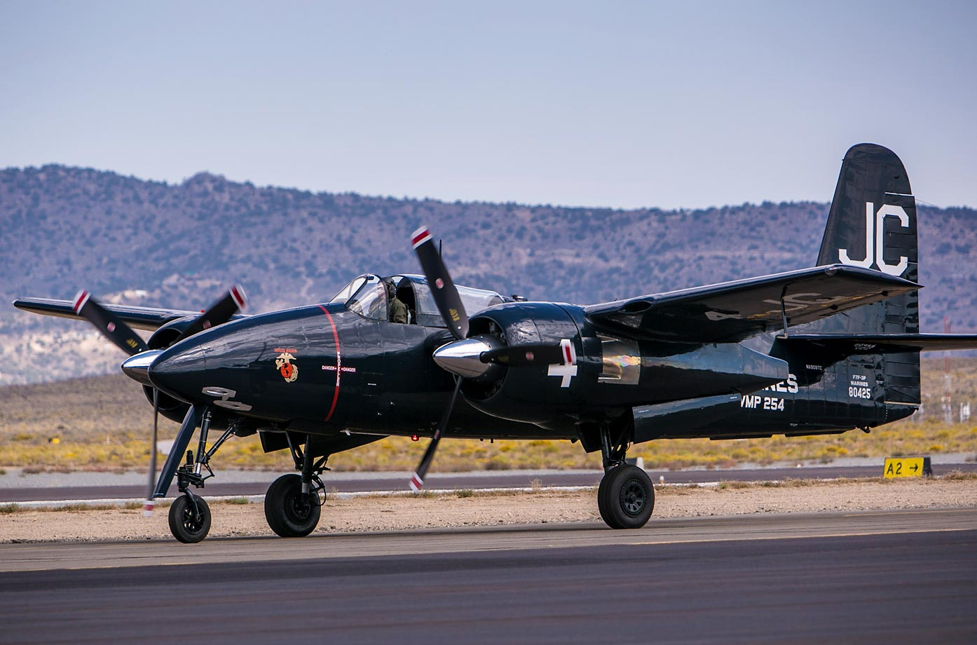 A P-38 Lightning bomber plane taxis onto the Reno National Championship Air Races runway in 2013.