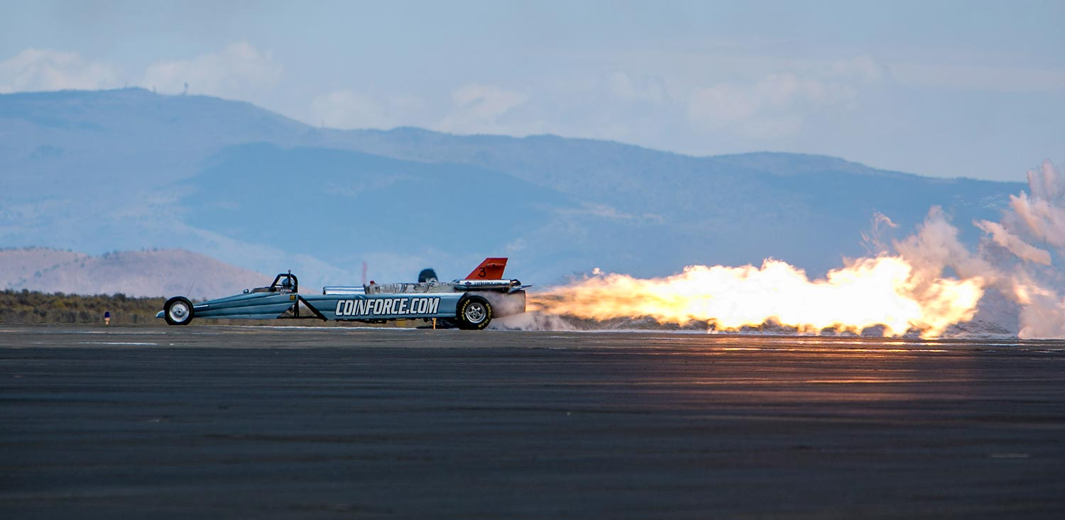 The Coinforce jet engine dragster performs at the Reno National Championship Air Races.