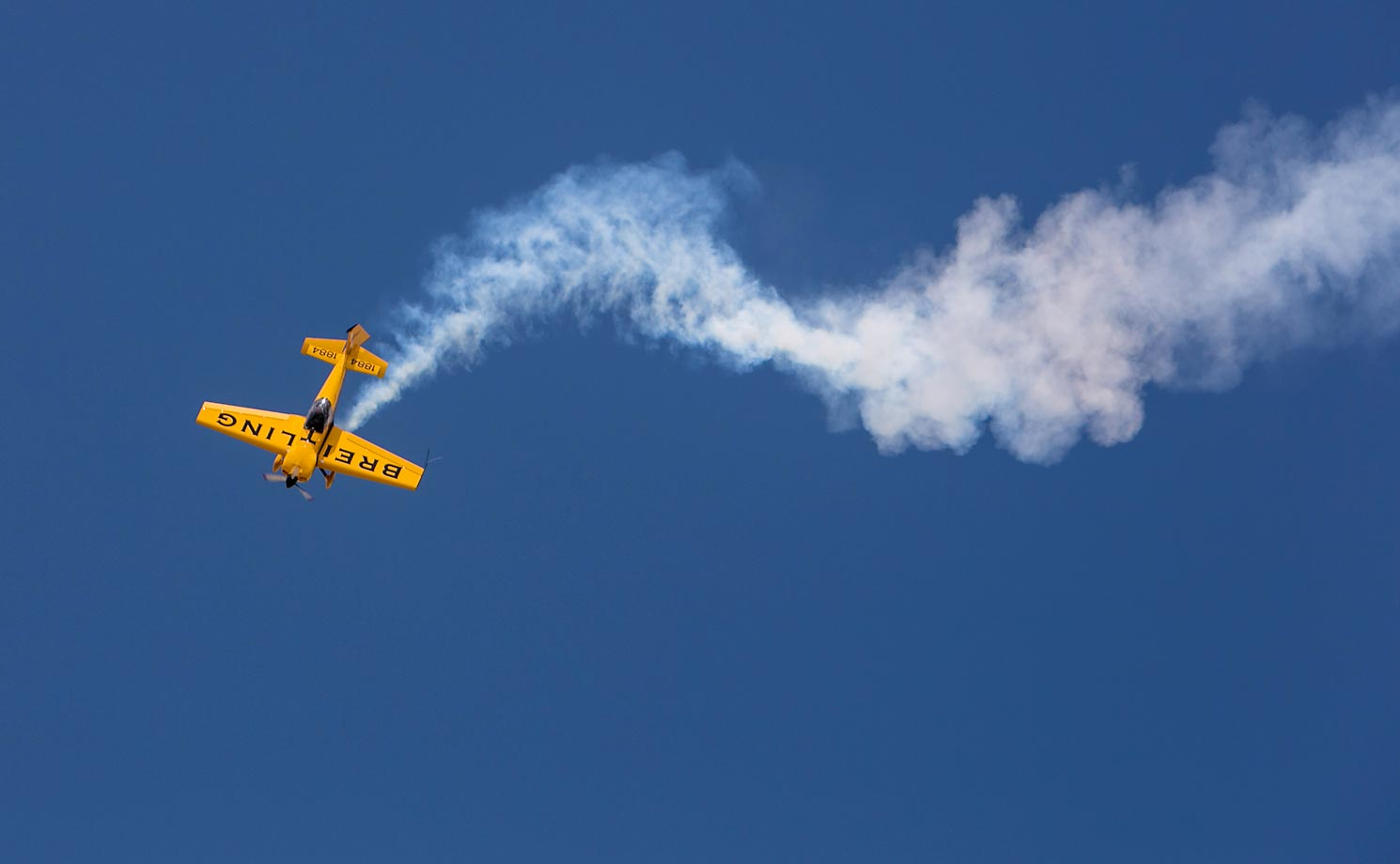 The Breitling stunt plane performs at the 2013 event. Fans at the 2014 gathering will be treated to the F-22 Raptor Demonstration Team, the L-39 Patriot Jet Team, the Breitling stunt pilot and a brand new entertainment area called The Drone Zone.
