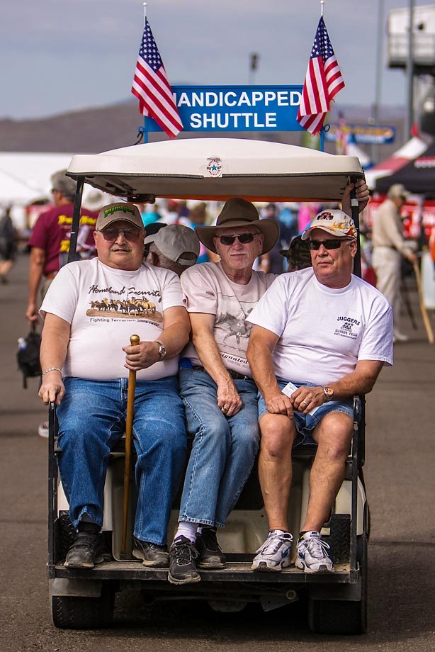 People ride the handicapped shuttle at the national championships.