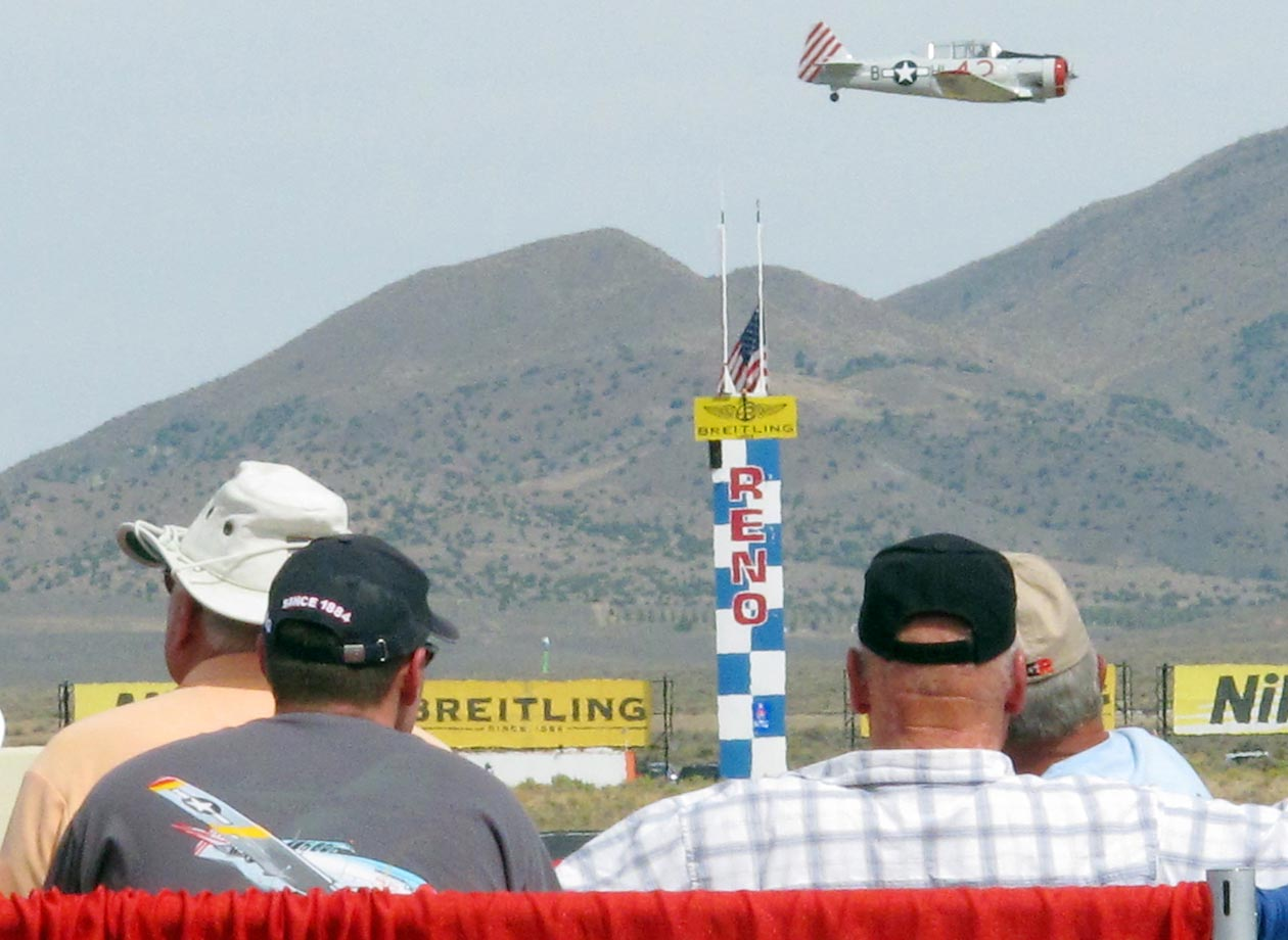 Spectators watch Rob Sandberg cross the finish line in his SNJ-4 Honest Entry in the T-6 class prelims in 2012. Fans will be treated in 2014 to two of the winningest Unlimited pilots in history going head-to-head -- Bill Destefani vs. Steve Hinton.
