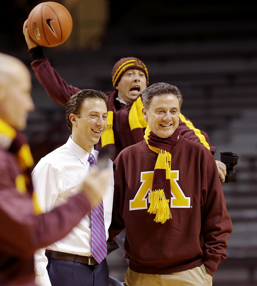 Rick Pitino of Louisville with son Richard, who's head coach of Minnesota. Behind them is Pitino's other son, Michael.
