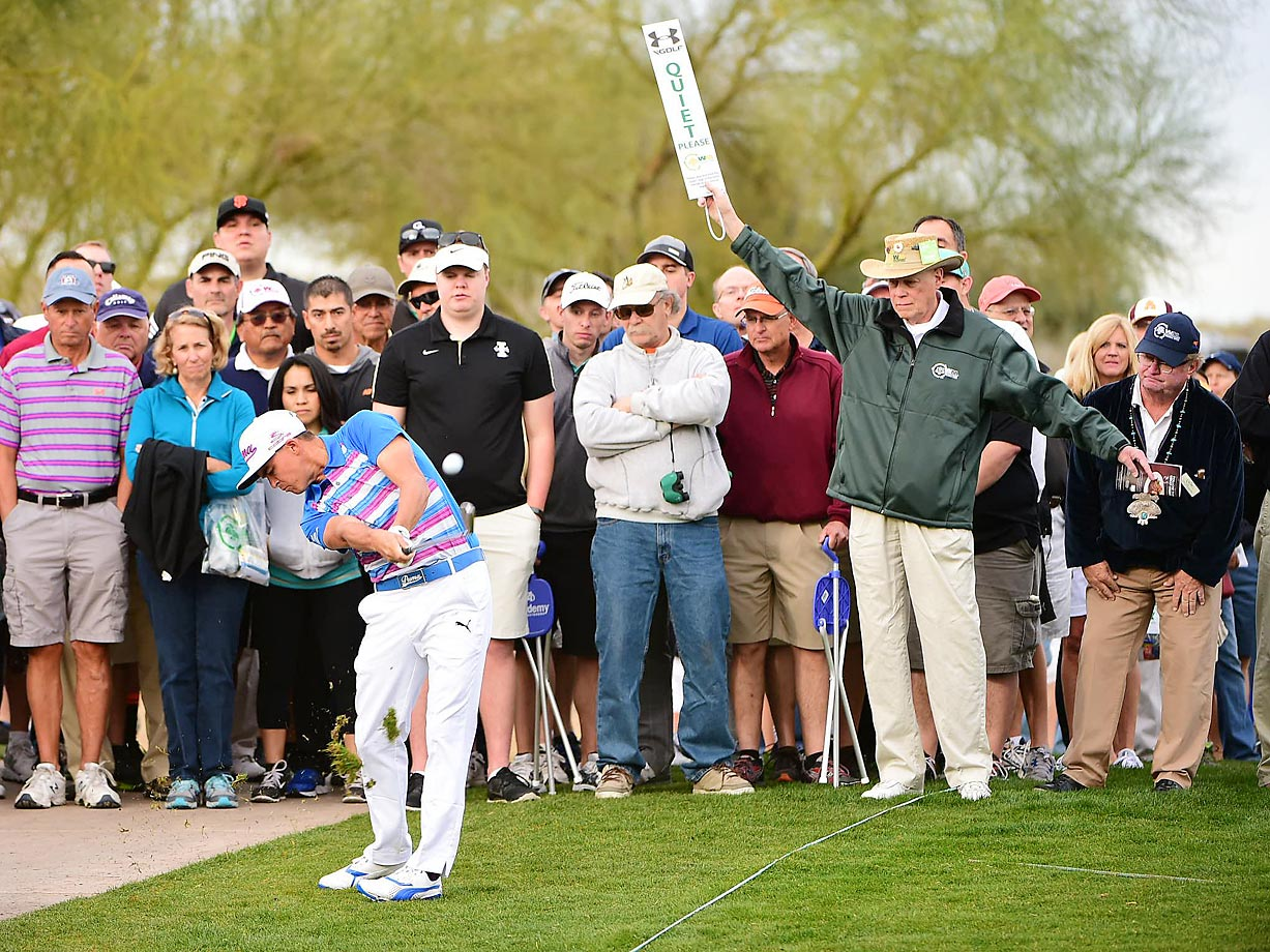 Rickie Fowler hits from the rough during Round 1 of the 2015 Waste Management Phoenix Open.