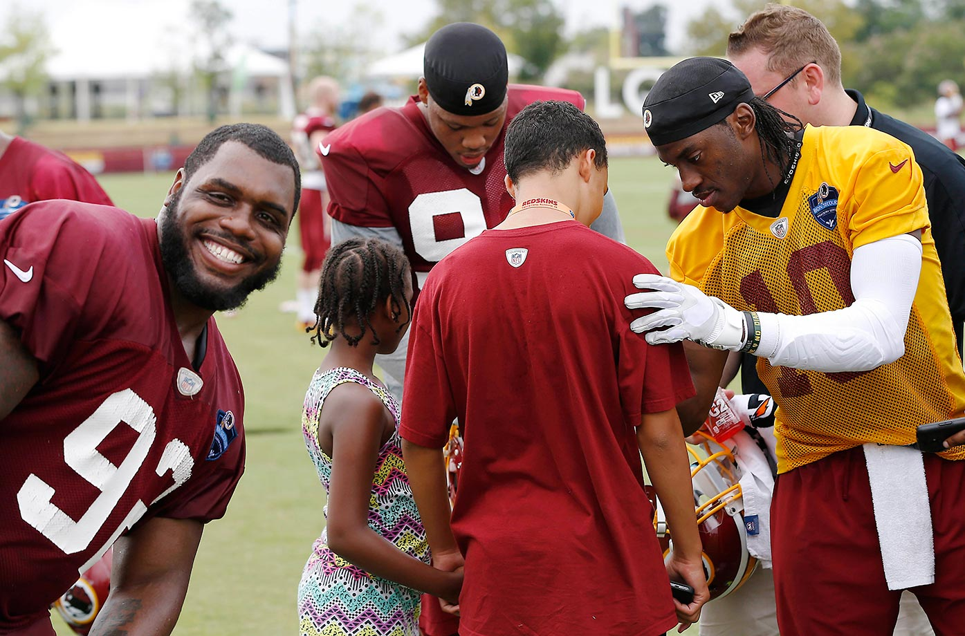 Robert Griffin III of the Washington Redskins is photobombed by Chris Baker.