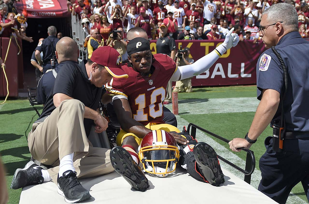Robert Griffin III gets carted off the field after suffering yet another injury.