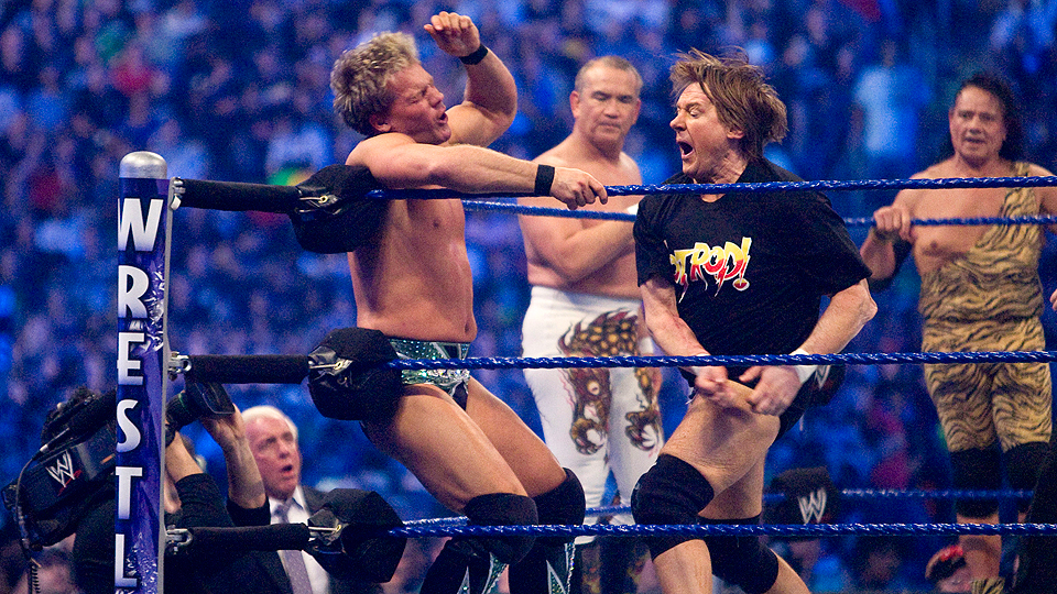 'Rowdy' Roddy Piper (right) fights Chris Jericho during WrestleMania 25.