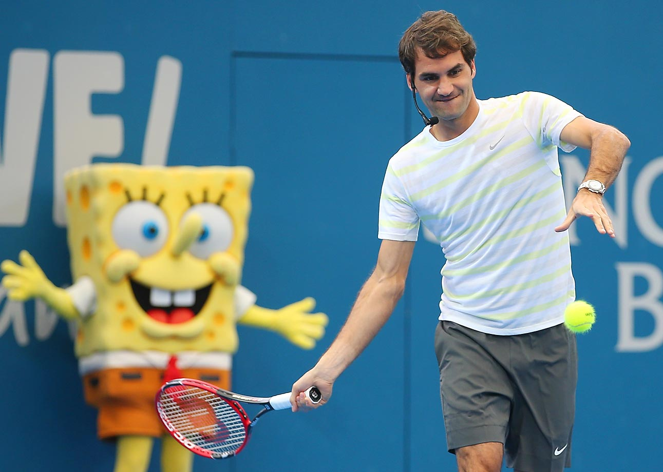 Roger Federer, with SpongeBob looking on, takes part in the Pat Rafter Arena Spectacular.