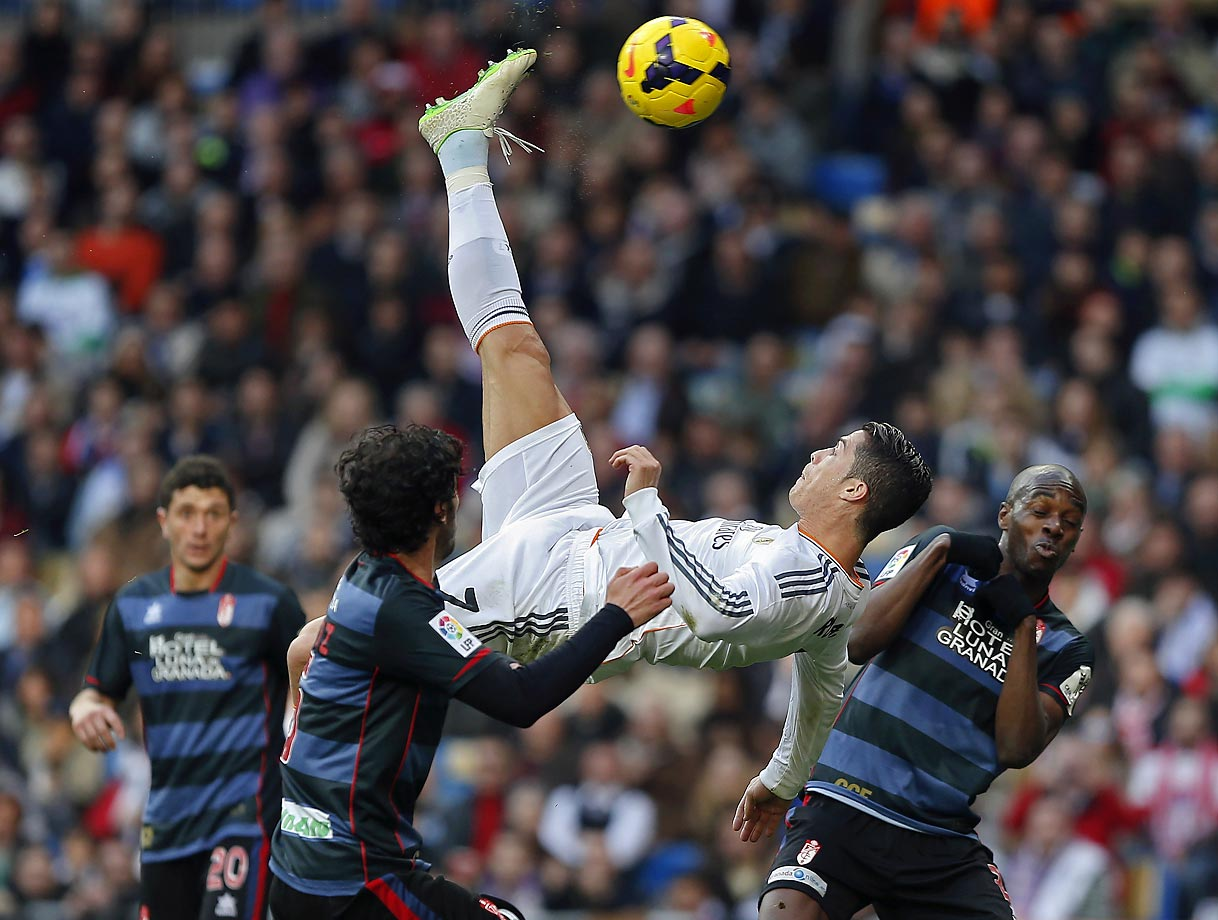 Real Madrid's Cristiano Ronaldo attempts to score on a bicycle kick during a La Liga match against Granada.