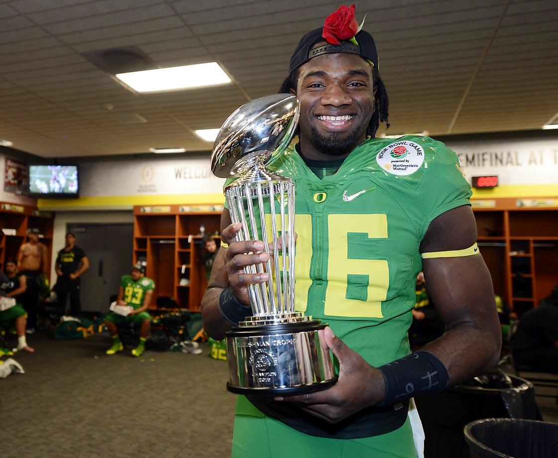 Torrodney Prevot of Oregon celebrates in the locker room after winning the Rose Bowl.