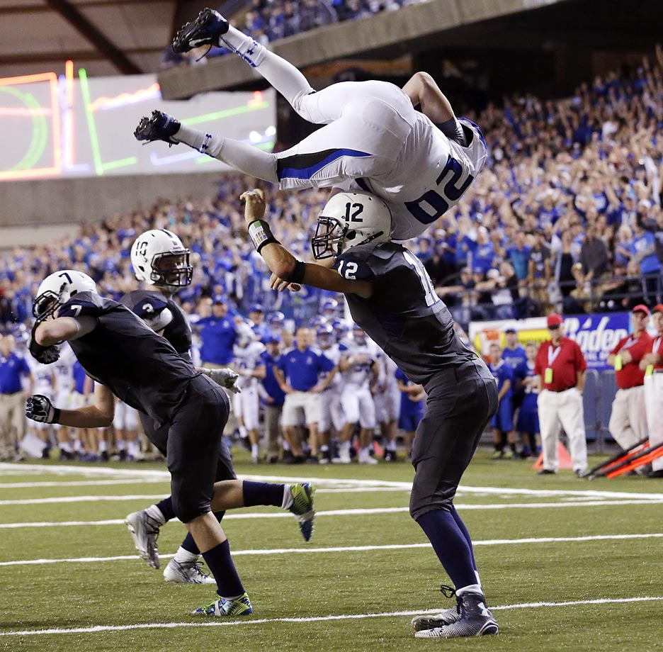 Bothell quarterback Ross Bowers flips into the end zone against Chiawana for a touchdown in the second half of the Washington state class 4A high school football championship.