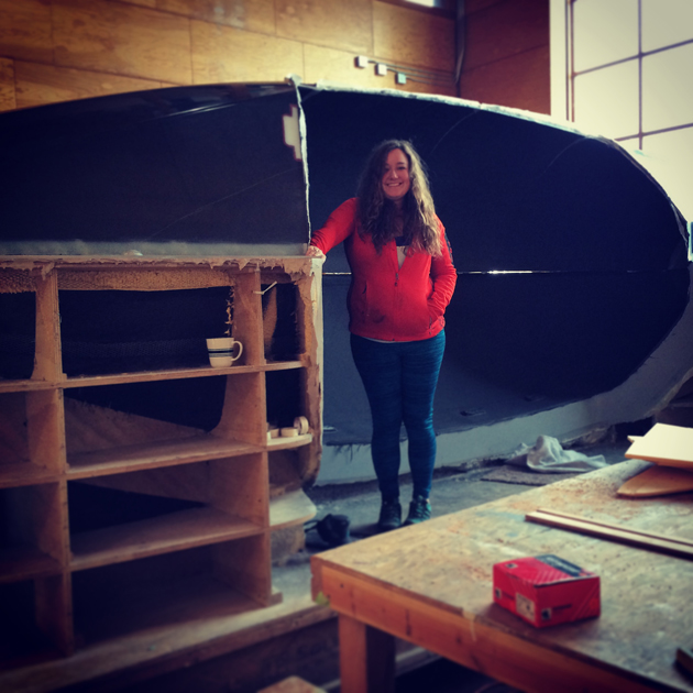 Sonya with her boat in the early stages of its construction.