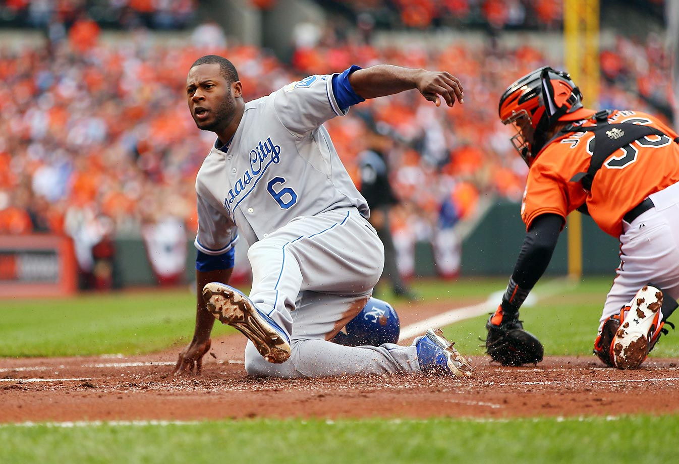 Kansas City's Lorenzo Cain scores in the first inning of Game 2 of the ALCS, against Baltimore.