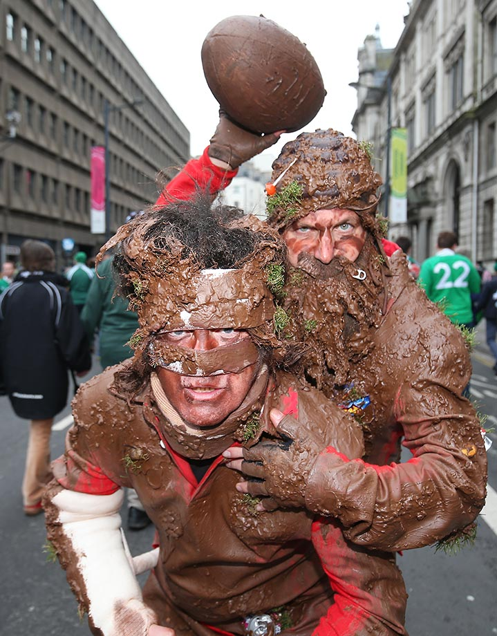 Rugby fans dressed as muddy players get ready for a game where Ireland played Argentina in the quarterfinals of the Rugby World Cup 2015.