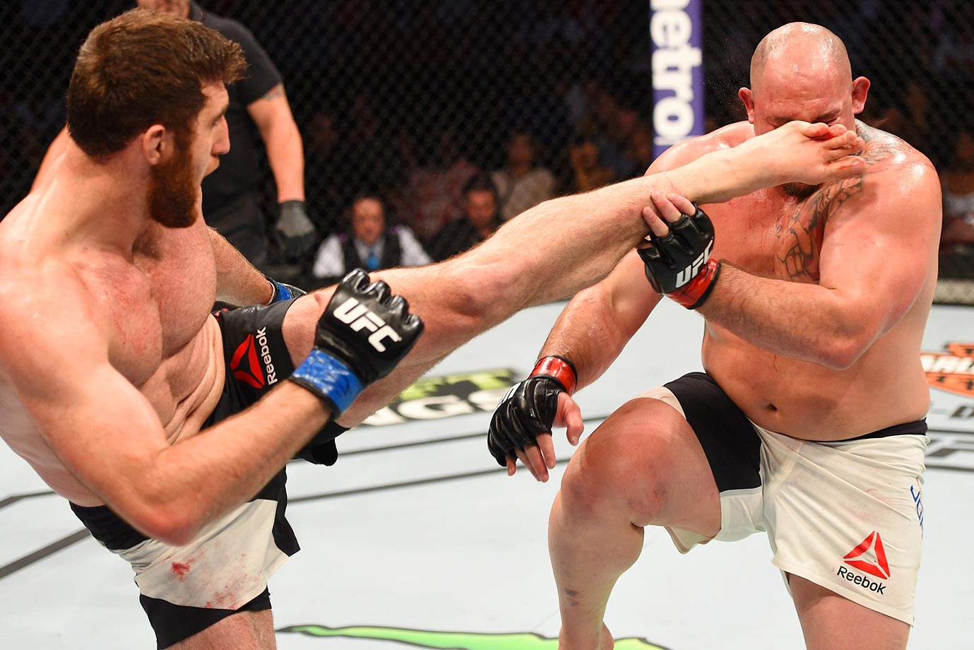 Ruslan Magomedov kicks Shawn Jordan in their heavyweight bout during the UFC 192 event.