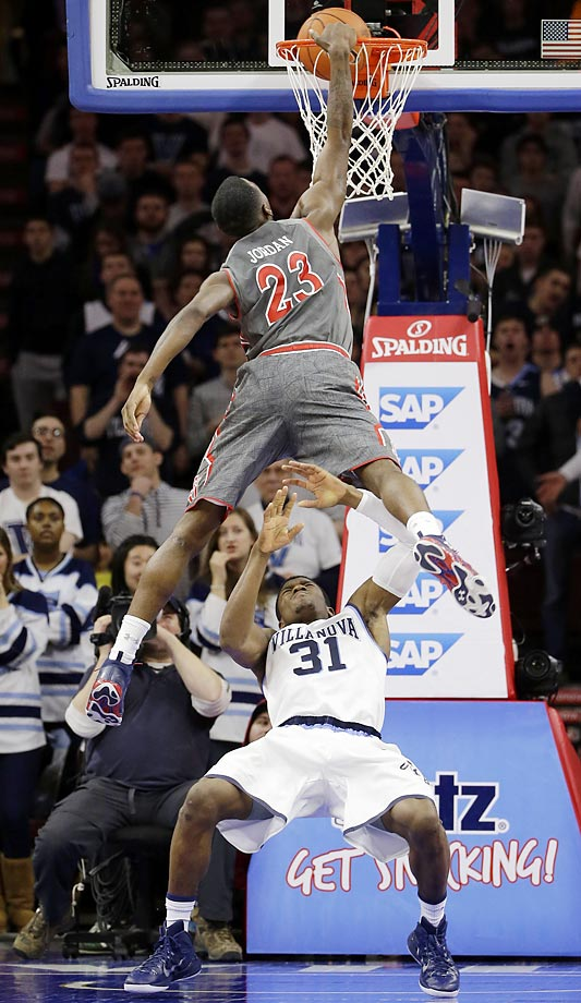 Rysheed Jordan of St. John's goes up and over for a dunk against Dylan Ennis of Villanova.