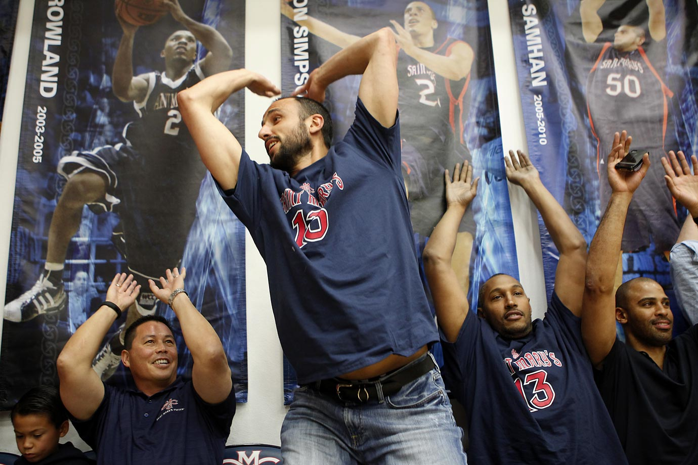 San Antonio Spurs' Manu Ginobili and Boris Diaw take part in the wave with fans.
