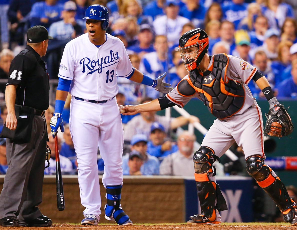 Kansas City Royals catcher Salvador Perez argues with the umpire after being tagged by San Francisco Giants catcher Buster Posey in Game 1 of the World Series.