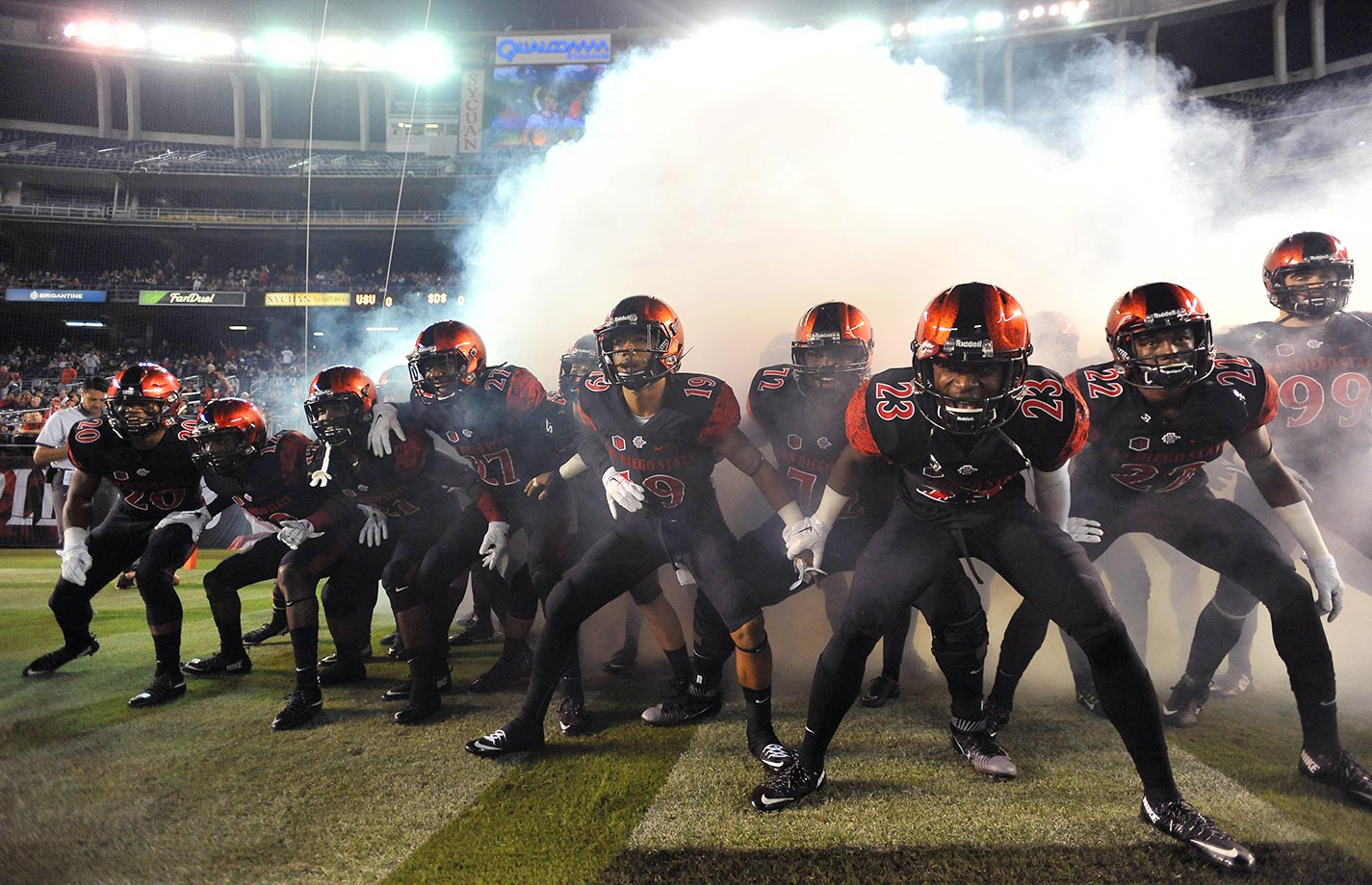 San Diego State Aztecs players enter the field before a game against Utah State. The Aztecs won 48-14.