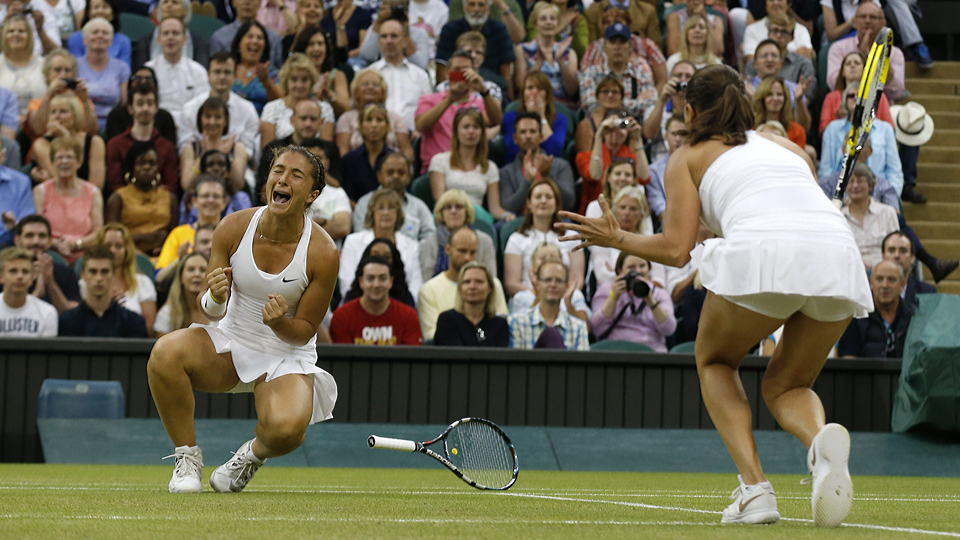 Sara Errani and Roberta Vinci defeated Kristina Mladenovic and Timea Babos to win their first Wimbledon doubles title.